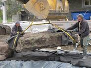 Landscape Contractor sets boulders