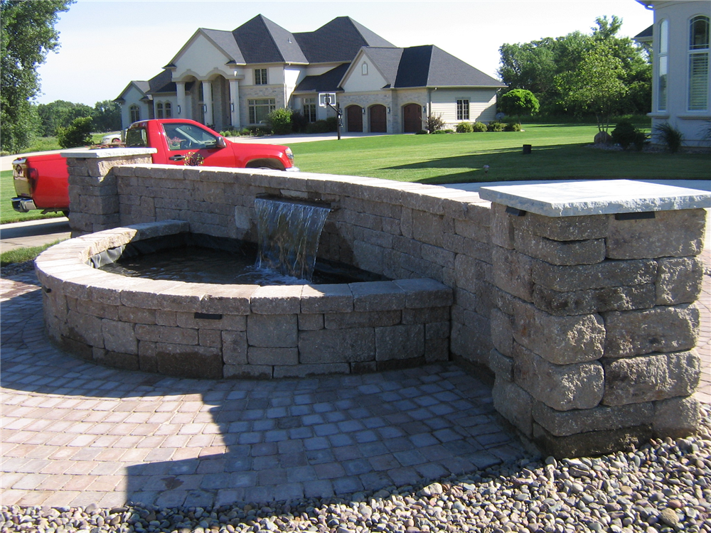 This was a Custom Formal Falls project where the contractor incorporated a 6ft Formal Falls into his driveway project.